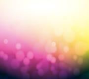 Purpurroter und gelber bokeh Zusammenfassungs-Lichthintergrund. Lizenzfreies Stockbild