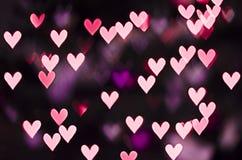 Purpurrotes Herz bokeh stockbild
