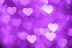 Purpurrotes Herz bokeh Hintergrundfoto, abstrakter Feiertagshintergrund Lizenzfreie Stockfotos