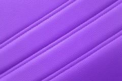 Purpurrotes Leder für Beschaffenheitshintergrund vom Büro-Stuhl stockfotos