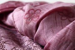 Purpurrotes textil Stockbilder