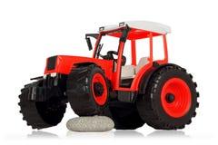 Purpurrotes Traktorspielzeug Stockfotos
