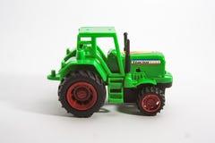 Purpurrotes Traktorspielzeug Lizenzfreie Stockfotos