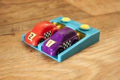 Purpury 3 I Czerwony Bieżny samochód Zdjęcie Royalty Free