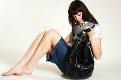 Purse. Teenager looking through her bag royalty free stock image