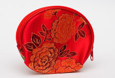 Purse. A red purse with flowers illustrations on it, used by little girls Stock Photography