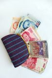 Asian countries money in purse Stock Image