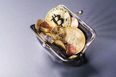 Purse with Bitcoin and other coins Royalty Free Stock Photography