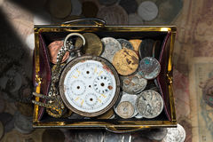 Purse with Broken Pocket Watch and Coins Royalty Free Stock Images