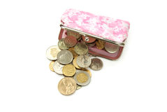 Purse with coins. Assorted world coins with purse isolated over white Royalty Free Stock Images