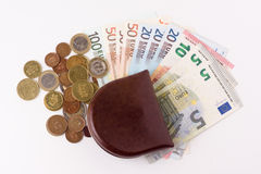 Purse with coins and banknotes Royalty Free Stock Photography