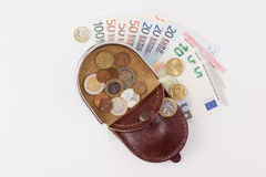 Purse with coins and banknotes Royalty Free Stock Photos