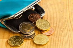 Purse with coins. debt and poverty. An empty wallet with a few euro coins. photo icon on debt and poverty Royalty Free Stock Image