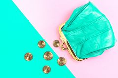 Purse for coins. A leather purse, wallet on a Geometric pink and turquoise background. Abundance, accessory, bag, bank, banking, business, cash, cent, change stock image
