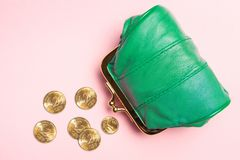 Purse for coins.Wallet for change. Leather purse, purse on a pink background. Color of the trend.The concept of poverty. Abundance, accessory, bag, bank royalty free stock photography