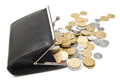 Purse and coins on a white Stock Photos