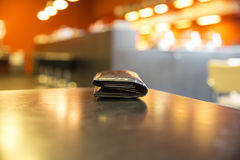 Purse with credit cards. On the table in the caf Stock Photos