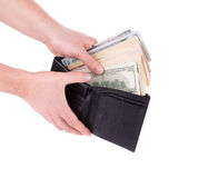 Purse with dollar bills in hand. Royalty Free Stock Images