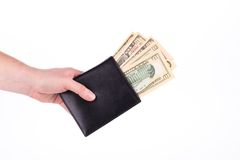 Purse with dollar bills in hand. Stock Images