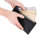 Purse with dollar bills in hands. Stock Images