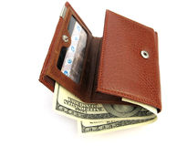 Purse with dollars. On a white background Royalty Free Stock Images