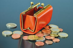 Purse and euro coins. Opened leather purse with some euro coins around royalty free stock photography
