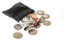 Purse with euro and dollar banknotes with some coins. A leather coin purse with euro and dollar banknotes inside and some coins royalty free stock photography