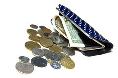 Purse filled with money. Old purse filled with coins and dollars Royalty Free Stock Photography
