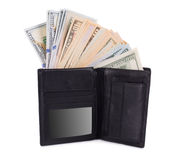 Purse full with dollar bills. Royalty Free Stock Image