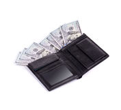 Purse full with dollar bills. Stock Images