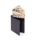 Purse full with dollar bills. Stock Photo