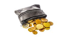A purse full of euro coins with open zipper royalty free stock photos