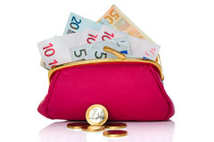 Purse full of money isolated on white Stock Image