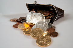 Purse full of silver and gold coins Royalty Free Stock Photo