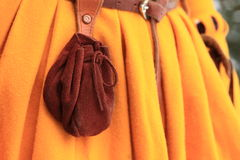 Purse on girl´s dress Stock Photography