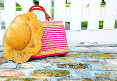 Purse and hat by gate Royalty Free Stock Image