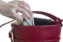 Purse Heist. Money being taken out of red purse on white background royalty free stock image