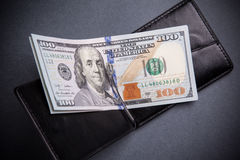 Purse with hundred dollar banknotes Stock Images