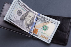 Purse with hundred dollar banknotes Stock Photo