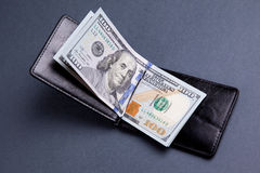 Purse with hundred dollar banknotes Stock Photography