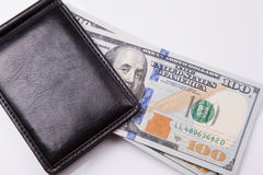 Purse with hundred dollar banknotes Royalty Free Stock Images