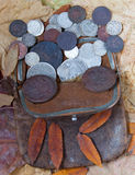 Purse with the last centuries. Old leather purse with silver coins of tsars of House of Romanovs of 18-20 centuries Royalty Free Stock Image