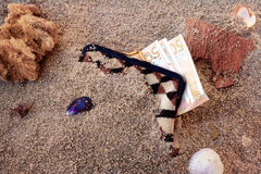 Purse lost in the sand. Still life about purse with money lost on the beach Stock Photos