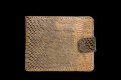 Purse made of leather lizard on a black background Royalty Free Stock Image
