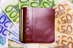 Purse on money background Stock Photo