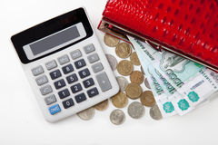 Purse with money and calculator Stock Photo