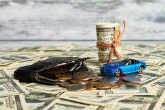 Purse, money and car. Stock Images
