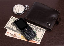 Purse money hours mobile phone Royalty Free Stock Photo