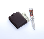 Purse & money & knife Stock Image