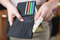Purse with money in woman`s hand Stock Photo